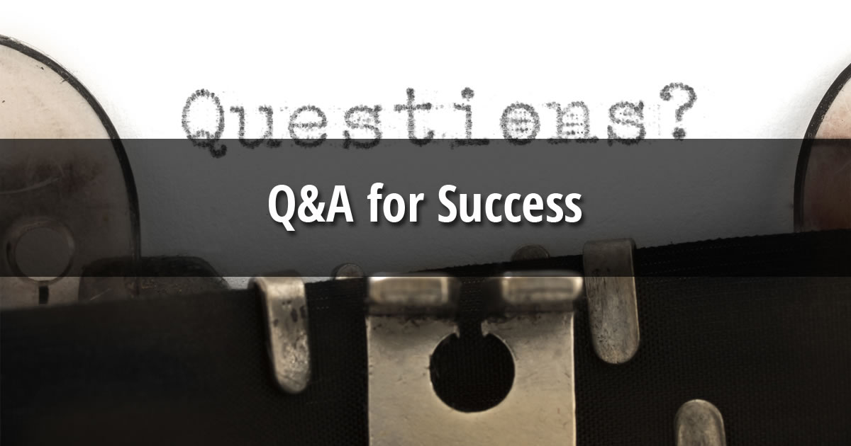 Paper in typewriter with the word Questions and text overlay of Q&A for Success